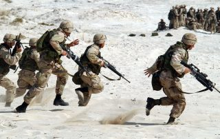 5-soldiers-holding-rifle-running-on-white-sand-during-87772